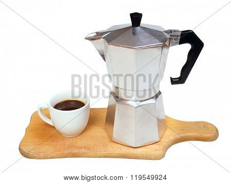 Metal coffee maker and coffee cup on a wooden board.