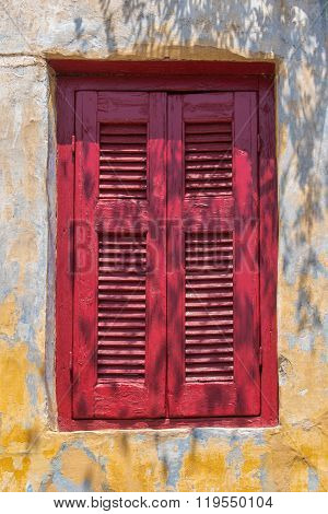 Enlightened Window With Red Shutter