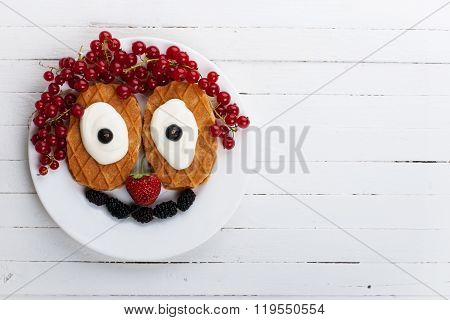 Breakfast with waffles and berries as a clown