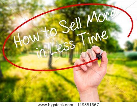 Man Hand Writing How To Sell More In Less Time With Black Marker On Visual Screen.
