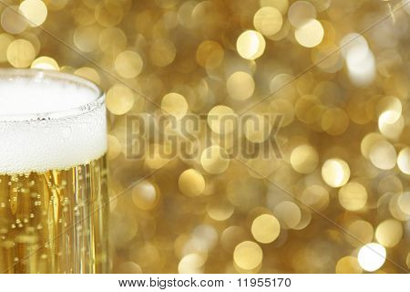 Glass of champagne against golden background