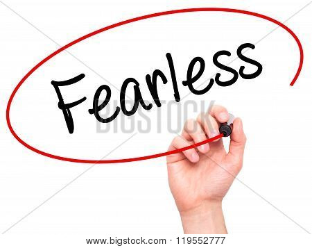 Man Hand Writing Fearless With Black Marker On Visual Screen.