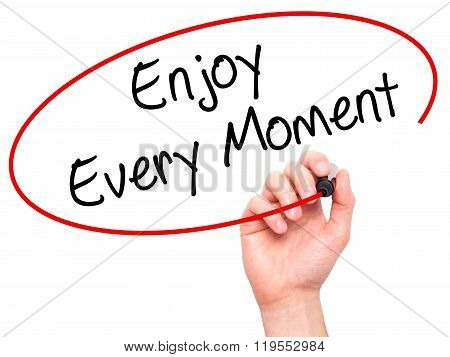 Man Hand Writing Enjoy Every Moment With Black Marker On Visual Screen.