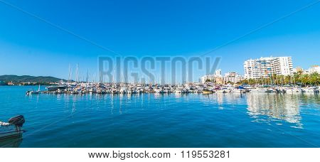 Marina by the city.  Boats in marina harbor in the morning of a warm sunny day in Ibiza, St Antoni d