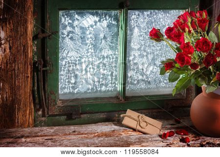Roses And Gift In Window