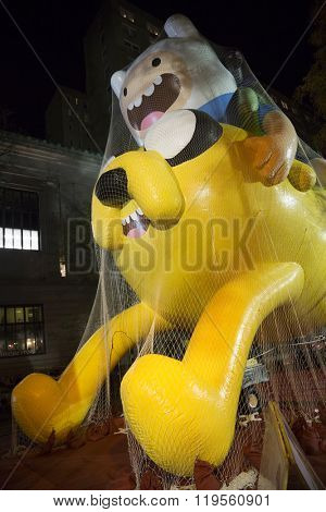 NEW YORK - NOV 25 2015: Cartoon Networks Adventure Time With Finn and Jake balloon tied down with sandbags and netting during Macy's Giant Balloon Inflation event held the day before Thanksgiving.