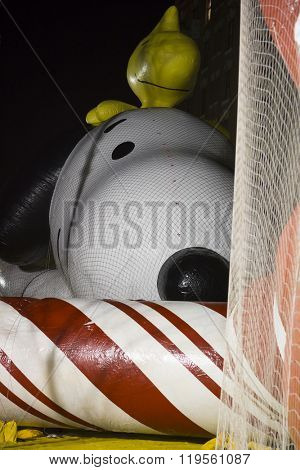NEW YORK - NOV 25 2015: The Snoopy and Woodstock balloon from Peanuts comics tied down with sandbags and netting during Macy's Giant Balloon Inflation event held the day before Thanksgiving.