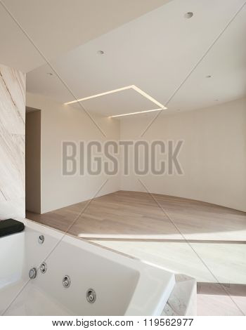 Interior of a modern house, wide empty room with jacuzzi