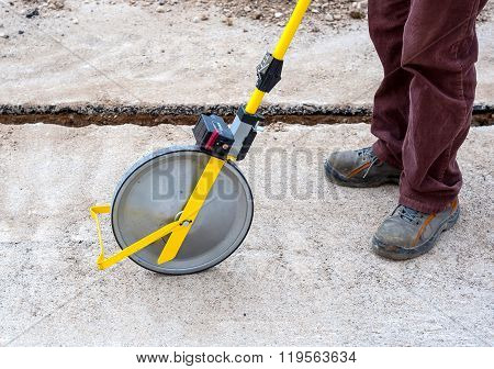 Surveyor with measuring wheel (odometer)