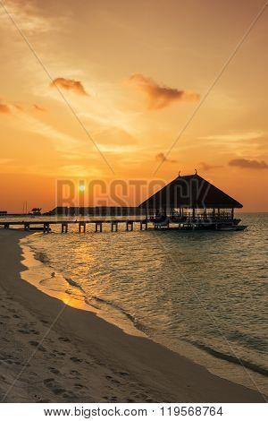 Sunset over a Maldivian jetty
