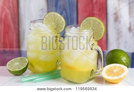 Glass Jars Filled With Cold Lemonade On Usa National Colors For The Holiday Season