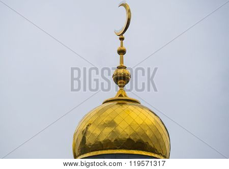 The dome of the mosque with a crescent of yellow metal