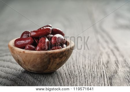red beans from can in wood bowl