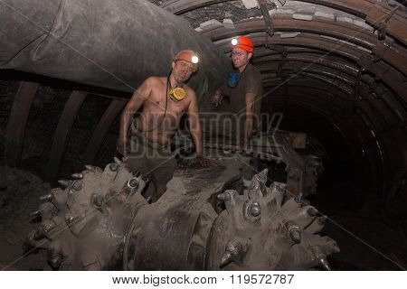 Donetsk, Ukraine - March 14, 2014: Drivers Of The Coal Miner Repairs In The Underground Mine. Mine I