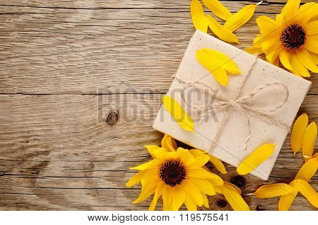 Decorative Sunflowers And Gift Box On Wooden Table Top View
