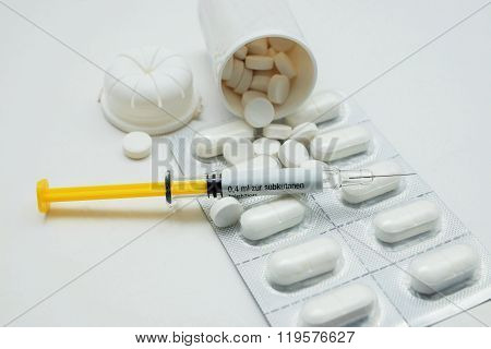 Syringe and pills