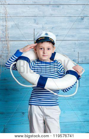 little boy wearing a life preserver