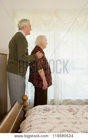 Elderly couple in bedroom