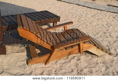 Wooden Chaise Lounge On The Beach