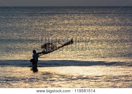 Fishermen On Bali Throws Net