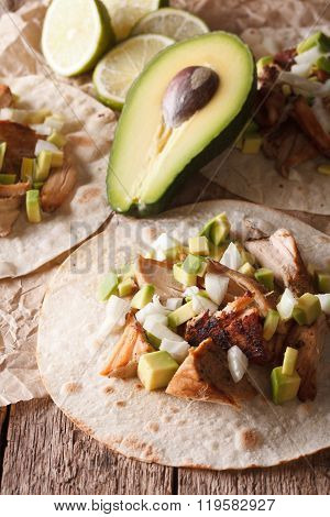 Carnitas Pork With Onion And Avocado On Tortilla Close-up. Vertical