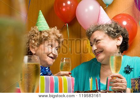 Two senior women at a party