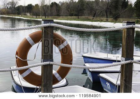 Orange Life Buoy On The Pier