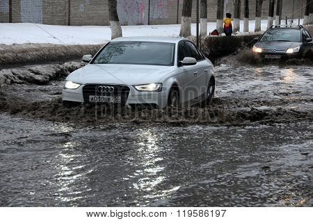 Cars In The Flooded Street In The Town Of Korolev