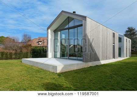 Exterior of a beautiful modern house, view from lawn