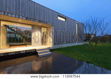 Entrance of a beautiful modern house, night scene