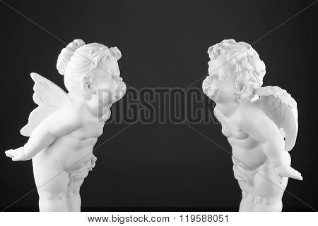 plaster figure angel with plaster figure fairy ...in black and white