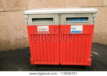 AUCKLAND, NZL -JAN 13 2016: Modern NZ Post Office mailing box outdoor.New Zealand Post is owned by the New Zealand government as a state-owned enterprise