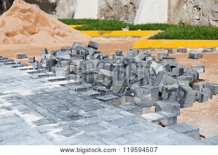 Process Of Building Road With Paving Stone