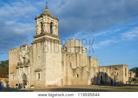 Main Entrance And Facade Of Mission San Jose In San Antonio, Texas At  Sunset