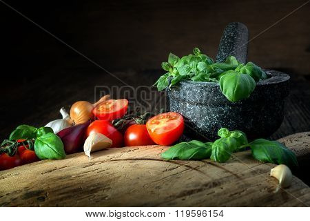 Wooden Board With Vegetables, Herbs And A Stone Grinder
