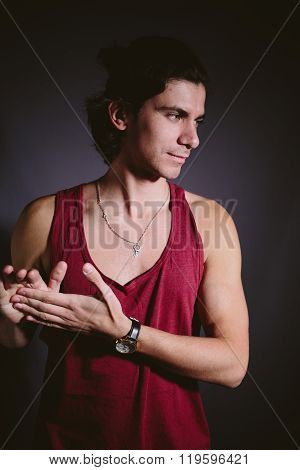 Young man athlete in a red undershirt.