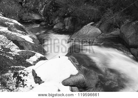 Rocks And Snow Water
