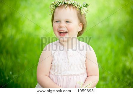 funny baby girl smiling outdoors