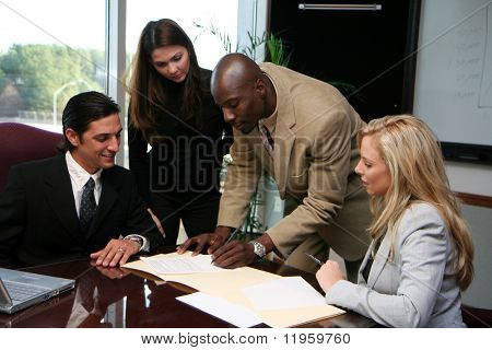 Young caucasian businesswoman with african american man