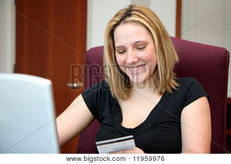 Woman shopping on the computer over the internet