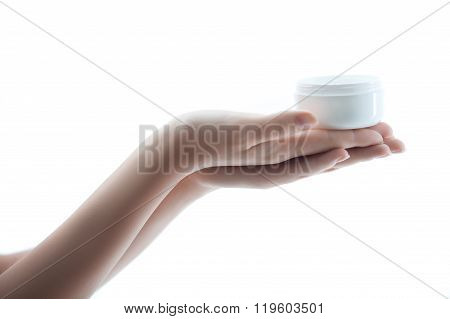 Cheerful young woman with moisturizer in hands