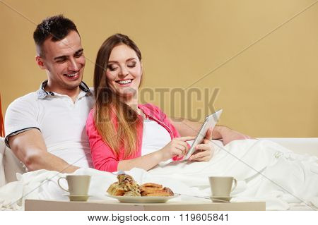 Couple Using Tablet Browsing Web Internet.
