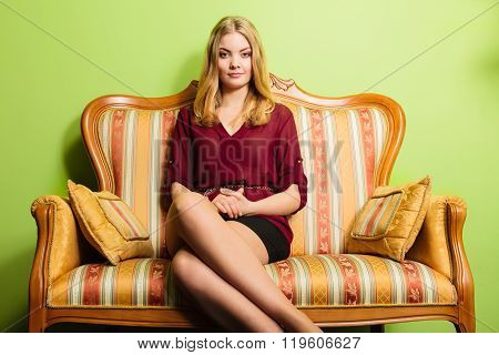Pretty Young Woman On Vintage Sofa. Fashion.