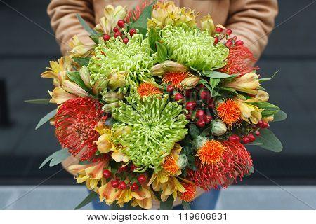 Bouquet of chrysanthemum, carthamus, nutans, hypericum and alstroemeria