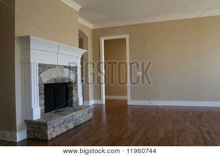Hardwood floor in a house with fireplace