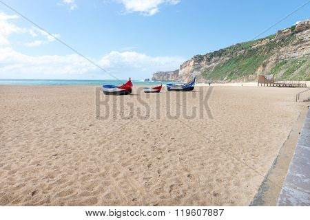 Main Beach In Nazare With Traditional Colorful Boats