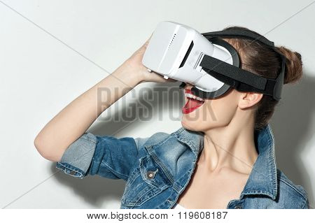 Attractive young woman is looking through a cardboard