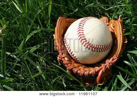 A baseball glove with a baseball
