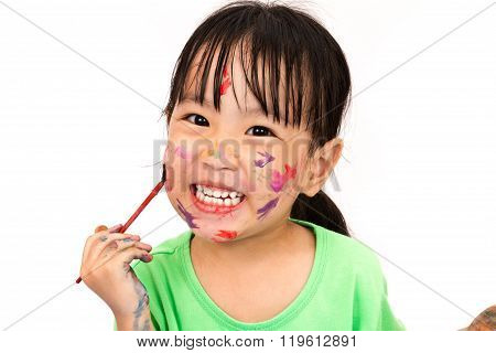 Asian Little Chinese Girl Playing And Painting