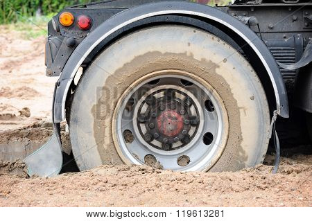 truck mired deeply in the mud, closeup truck tire